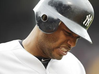 Robinson Cano grimaces after being hit by a pitch during the first inning of game one of a doubleheader against the Boston Red Sox at Fenway Park on Saturday, July 7, 2012 in Boston, Mass. Cano went homerless at the All-Star Game Home Run Derby on Monday night, July 10, 2012.