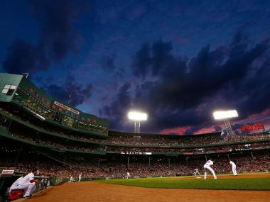 Ivan Nova of the New York Yankees pitches against the Boston Red Sox while the sun sets over Fenway Park during their game on July 8, 2012.