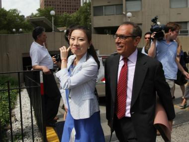 Former Liu campaign treasurer Jenny Hou smiles as she leaves court on July 10, 2012.