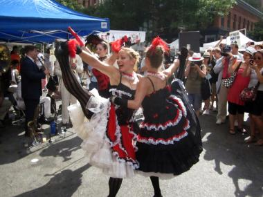 Can-can dancers at last year's Bastille Day celebration on West Broadway.