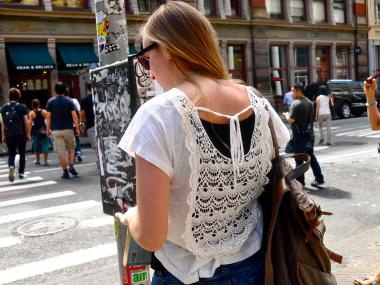 Sara Lewis, 24, who lives in Harlem, wears a white lace-backed blouse in SoHo.