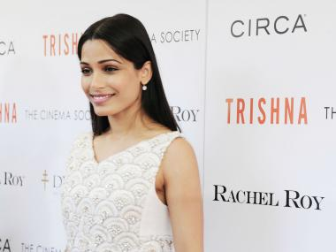 Freida Pinto, wearing Rachel Roy, at the Cinema Society screening of