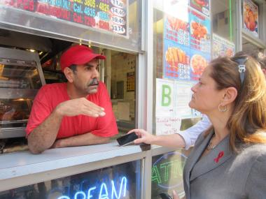 Lal Barak, owner of Crown Fried Chicken at Lexington Avenue and East 116th Street, tells East Harlem Councilwoman Melissa Mark-Viverito that Mayor Michael Bloomberg's soda ban would hurt his business.