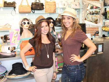 Maria Ruiz (right) and Ivon Asencio say fedora fashion is back
