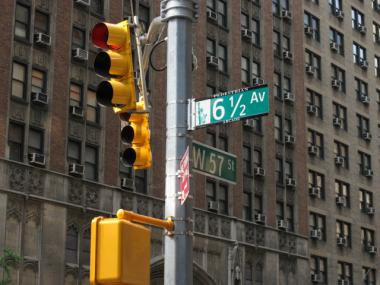 The new intersection at West 57th Street is the only one with its own traffic signal. Every other intersection has a stop sign.