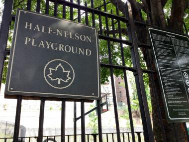 A sign outside the entrance to Half-Nelson Playground, where a dispute led to a fatal shooting on July 12, police say.