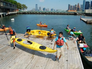 Kayakers brought their boats ashore during City of Water Day 2011.
