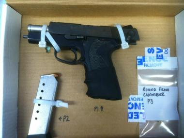The 45-caliber Smith and Wesson that police allegedly confiscated from the suspect.