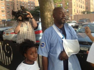 Hero Steve St. Bernard with his daughter, Tahaaani, after returning from the hospital with a torn bicep tendon from catching a little girl's fall from an AC unit in Coney Island on July 16, 2012.