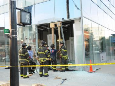 Fire Fighters shore up the damaged building on Tuesday July 17th, 2012.