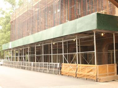 Scaffolding obscures the Patrick Basu health clinic on Greenway Terrace.
