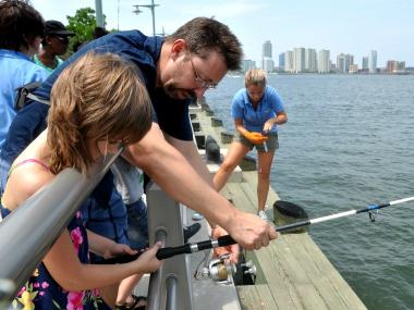 Eilidh and her father, Brian Kilpatrick, fishing on Tuesday, July 18, 2012, off Pier 25 on the Hudson River.