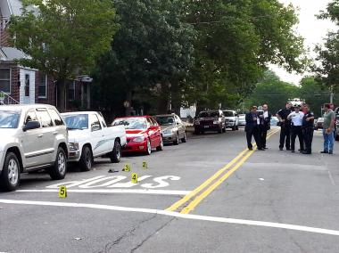 Authorities investigate a shooting at 130th Street and Sutter Avenue in South Ozone Park on July 18, 2012. The shooter may have been an off-duty FBI agent, sources said.