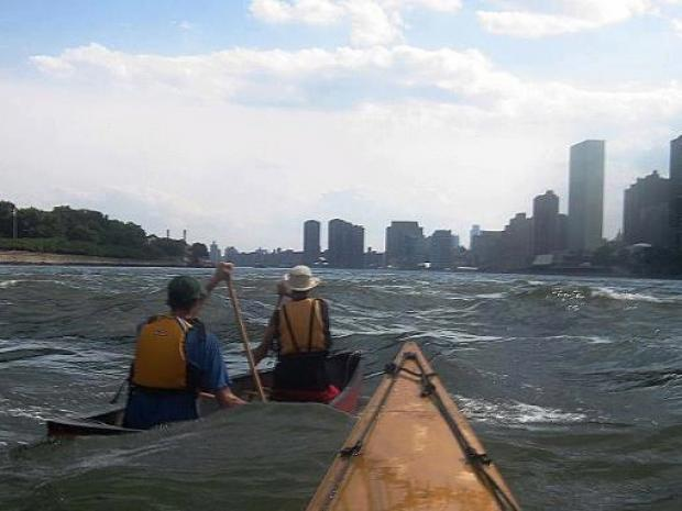 Kayaks and canoes are accessible for all members to launch on Newtown Creek.