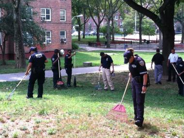 Police searched for evidence in the Forest Houses complex in the Morrisania section of The Bronx Tuesday, July 24, 2012.