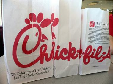 Chick-fil-a bags placed together to spell out 'Chick-fil-a.'