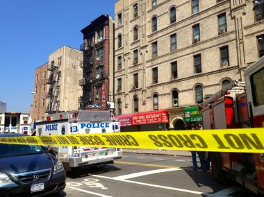 A knife-wielding suspect is barricaded in a Lower East Side apartment on August 2, 2012.