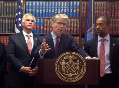 NYPD Chief Anthony Izzo, Manhattan District Attorney Cyrus Vance, Jr., and New York City Housing Authority Chairman John Rhea announce the indictment of 19 gang members on August 2, 2012. The gang are accused of selling cocaine in Harlem's Wagner Houses and Taino Towers.