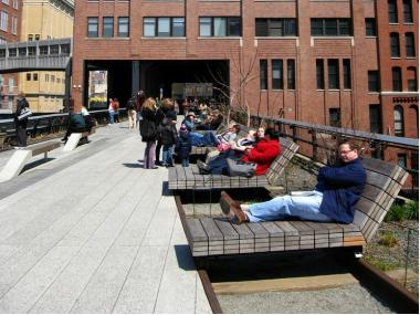 Visitors enjoy the High Line at West 14th Street.