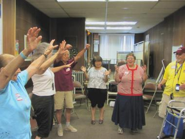 Participants practice making 'frozen images' as part of theater training.