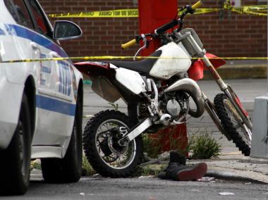 A dirt bike is parked near the scene of a crash in The Bronx that left the bike driver dead, Aug. 11, 2012.