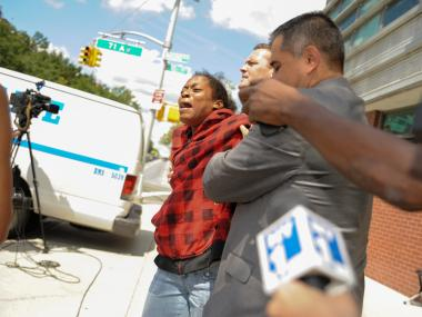 Suspect Afriyie Gaspard struggles with Detectives as she is removed from the 107th Precinct in Queens on Monday August 13th, 2012.