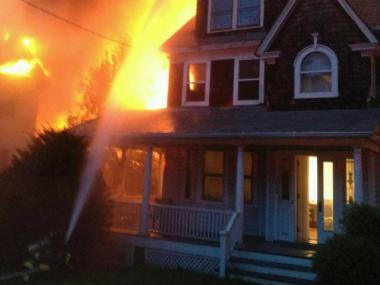 Firefighters battled a three-alarm blaze at 39-12 Douglaston Parkway Aug. 14, 2012.