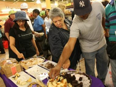 Shoppers picked up samples of pound cake at 55 Fulton Market Aug. 15, 2012.