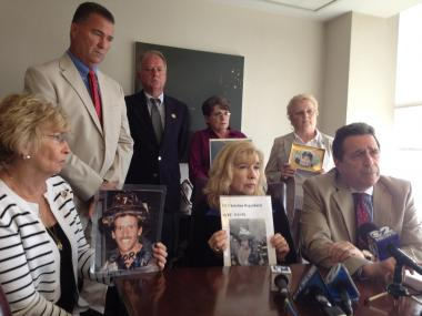 From left to right: 9/11 victims' parents Rosemary Cain, retired FDNY deputy chief Jim Riches, Russell Mercer, Sally Regenhard, Joyce Mercer, Eileen Walsh and attorney Norman Siegel gather at Siegel's Midtown law office to discuss an appeal they have filed to obtain the names and addresses of all the 9/11 victims' families.