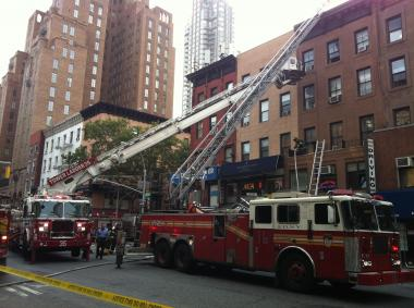 Firefighters battle a blaze at 797 Lexington Ave. Tuesday.