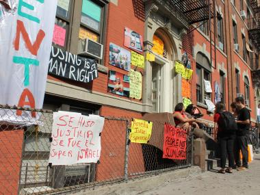 Posters covered the front of the building at 553 46th St. in Sunset Park Monday afternoon, Aug. 20, 2012.