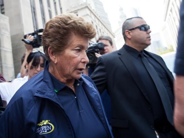 "Lois Ann ""Lolo"" Goodman, 70, is led out of Manhattan Supreme Court on August 23rd, 2012."