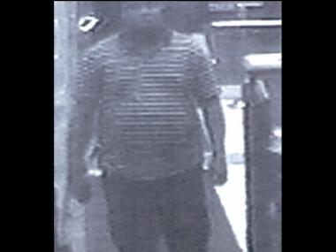 Man suspected of impersonating a cop to rob a spa in Midtown on June 21, 2012.