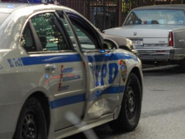 Four people, including a young boy, were injured when a marked police car collided with a sedan on Greene Avenue at Reid Avenue in Brooklyn on Sept. 4, 2012. The injured were removed to nearby hospitals. The extent of their injuries are not known at this time. The cause of the accident is unkown.