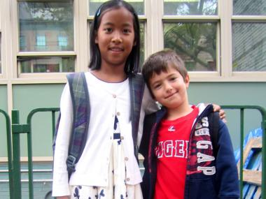 Lydia Cresci, 8, chose a patterned dress for her first day of fourth grade at P.S. 41 in Greenwich Village Sept. 6, 2012. Her brother Nicholas, 6, chose a more casual look.