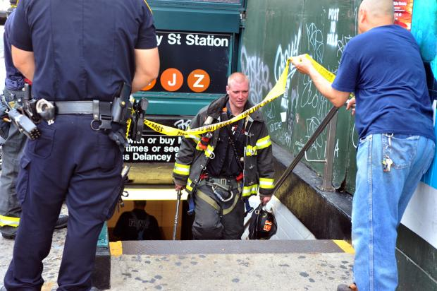 J and M train service was suspended in both directions after smoke inside the Essex Street station.