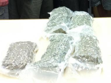 The boxes contained sealed plastic pouches of pot estimated to weight around 10 lbs.