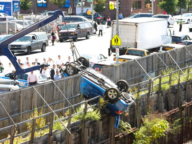 An out-of-control vehicle plunged 40 feet into a construction site in Brooklyn on September 12, 2012.