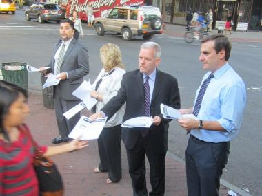 State Senator Michael Gianaris, Council Member Jimmy Van Bramer, Adrian Bordoni, Executive Director of Woodside on the Move and Debbie Markel, District Manager of Community Board 2 are handing out fliers with a description of the perpetrator.
