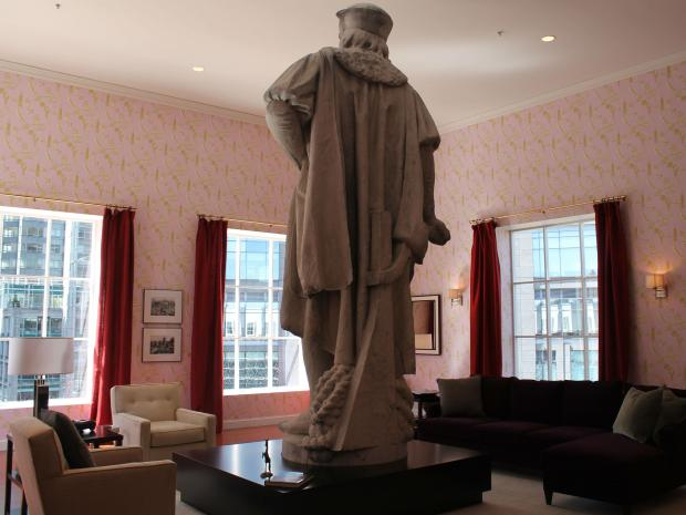 Furntiture of Columbus' living room are for sale, complete with the handprints of thousands of tourists.