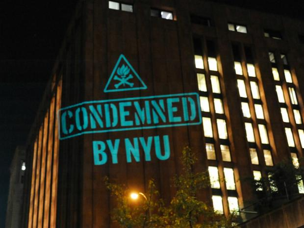 Faculty opposed to NYU's expansion plan projected images criticizing the plan on school buildings.