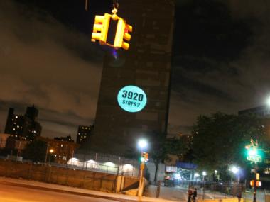 The researchers, calling themselves the Morris Justice Project, projected results of a survey about police interactions onto a building at Park Avenue and 161st St. in The Bronx.