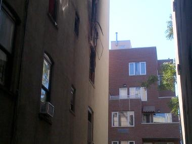 Broken windows at 426 E. 118th St. where a fire damaged 12 apartments Sunday, Sept. 23, 2012.