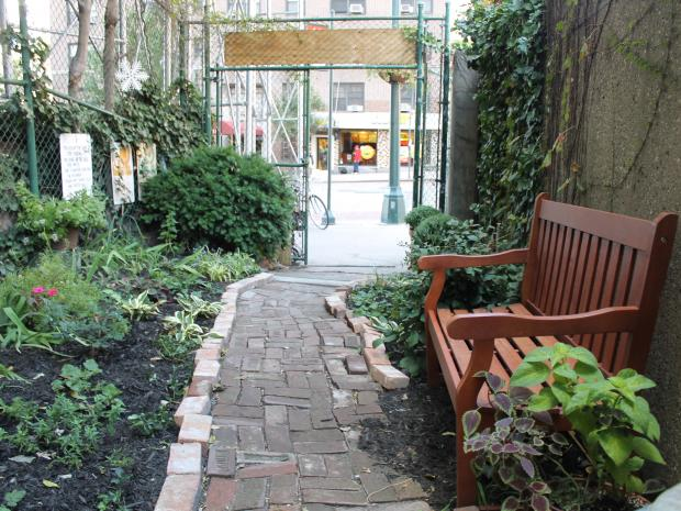 Officials and community groups re-opened Alice's Garden on West 34th Street on Monday.