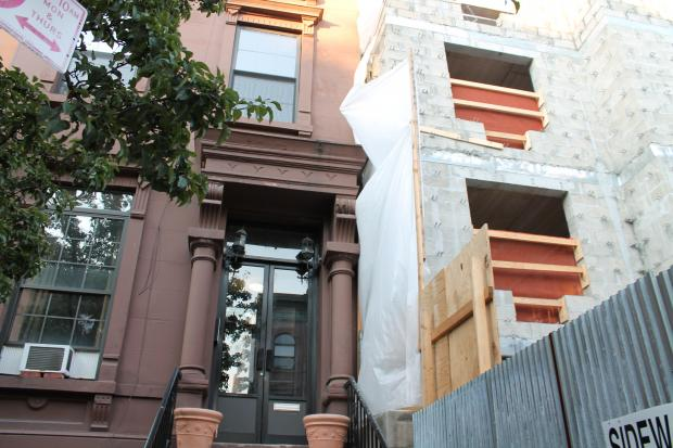 "The owner of a three-story apartment building on West 123rd Street says that a construction firm hired by the development arm of Abyssinian Baptist Church dumped contaminated construction debris in his backyard and so badly destablized the building he ""will be forced to vacate and demolish,"" the structure, according to a lawsuit filed in State Supreme Court"