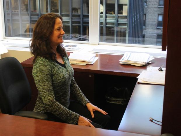 Fitness expert Sheryl Dluginski demonstrates exercises that can be performed at a cubicle.