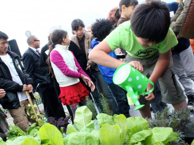The Earth School, along with non-profit the Fifth Street Farm, unvieled the garden Friday.