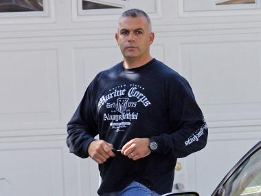 Detective Hassan Hamdy seen here outside his Long Island home.