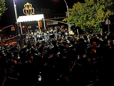 Rabbi Zalman Teitelbaum, one of the two Grand Rebbes of Satmar Hasidic Judaism, invited followers to watch his grandson Chaim Hersch Rosenberger marry Classoner Rav Scher on Bedford Avenue in Williamsburg, Brooklyn, Oct. 17, 2012.