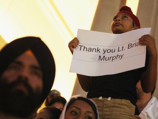 Windsor Terrace residents will hold a benefit Saturday night at Rhythm and Booze bar for Lt. Brian Murphy, the cop who was shot nine times when a white supremacist opened fire on a Sikh temple in Oak Creek, Wisc.